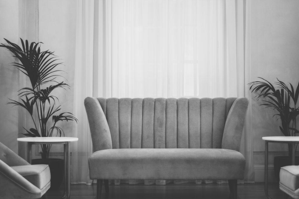 Grey velvet sofa after upholstery repair Glasgow