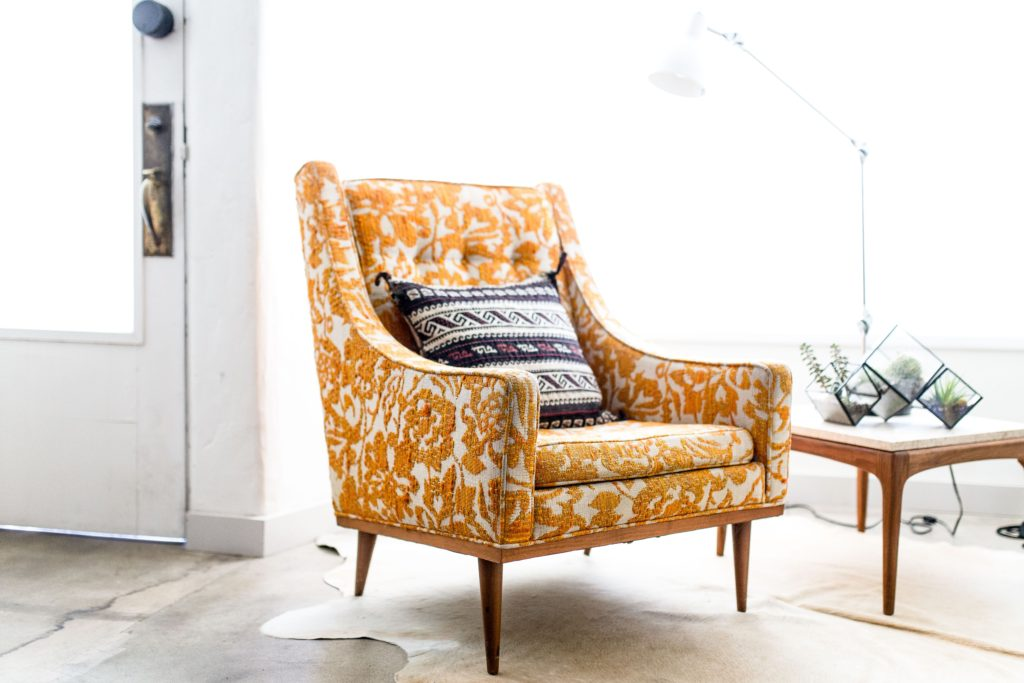 Chair with a lovely yellow flowery pattern after having upholstery repair Glasgow