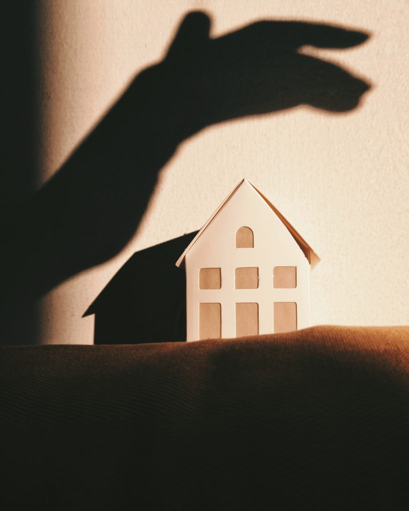 Small house protected by human hand